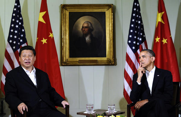 Chinese President Xi Jinping and President Obama talk to reporters after their first meeting at a summit in Rancho Mirage, Calif.