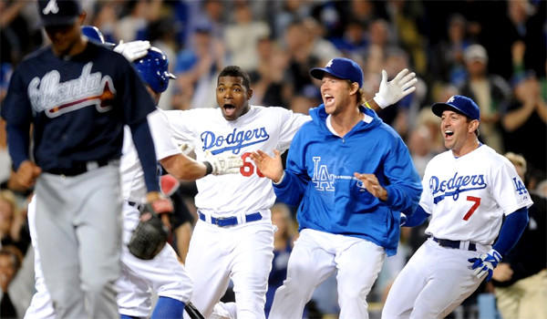 Skip Schumaker stole home -- and the game -- on a wild pitch by Anthony Varvaro, giving the Dodgers a 2-1 victory over the Atlanta Braves on Friday.