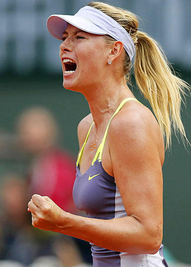 Maria Sharapova shows she's ready to play during the singles final match against Serena Williams at the French Open on June 8.