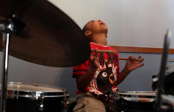 Aspiring drummer Marco Ramirez, 9, gets into his groove at the Neighborhood Music School in Boyle Heights.