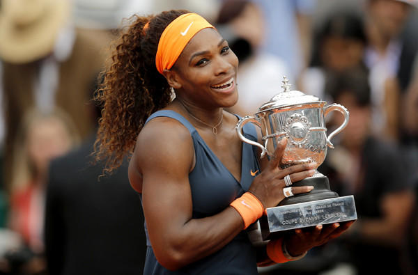 Serena Williams holds the Coupe Suzanne Lenglen after defeating Maria Sharapova, 6-4, 6-4, in the French Open women's final on Saturday at Roland Garros.