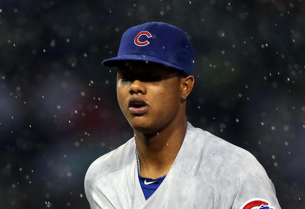 Starlin Castro runs to the dugout during a rain delay against the White Sox last month at US Cellular. (Scott Strazzante/Tribune photo)