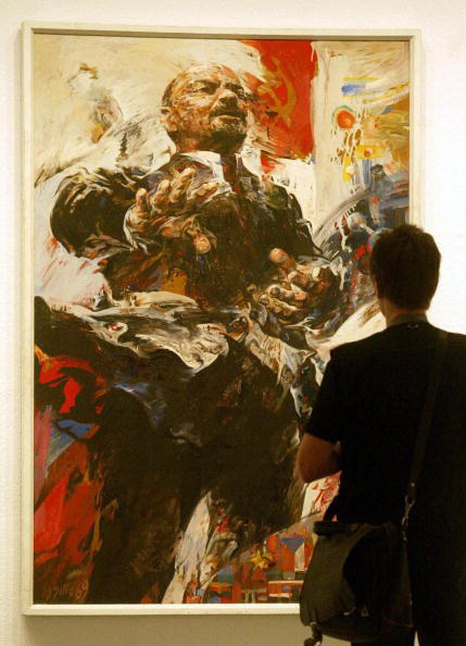 "A visitor views the painting ""Homage - Lenin"" (1969) by Willi Sitte prior to the official opening of the exhibition ""Kunst in der DDR"" (""Art in the GDR"") in Berlin's New National Gallery, 24 July 2003."