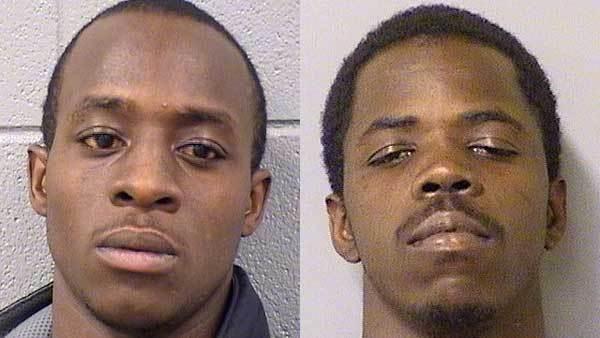 Booking photos of Robert Goodman, left, and Demetrius Spencer.