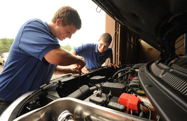 In Eldridge Watts' automotive technology class at Eastern Technical High School, Anthony Critcher, left, and Brik Wisniewski, both 18, demonstrating how they take apart the engine to learn how to fix it.