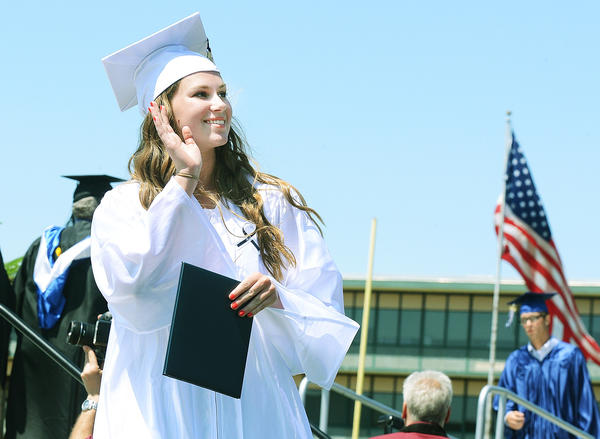 Aryn Rebok waves to family after receiving her diploma at graduation excercises for Chambersburg Area Senior High School Saturday.
