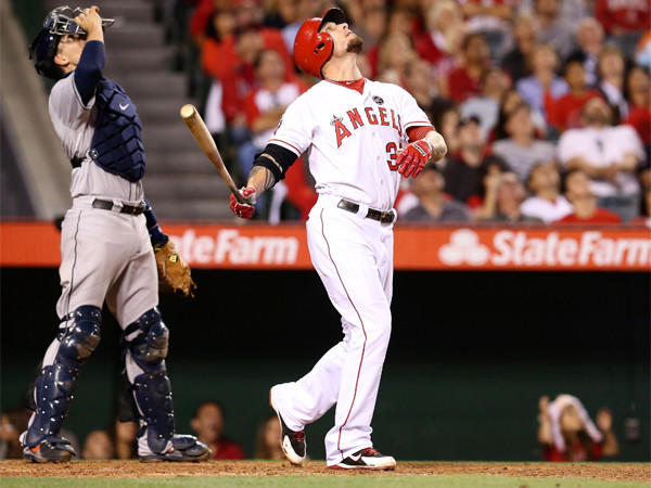 Josh Hamilton, shown after hitting a popup against the Houston Astros on May 31, has been moved in the Angels' lineup again in hopes of solving his batting woes.