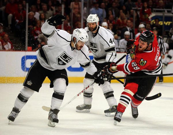 Chicago Blackhawks left wing Bryan Bickell (29) shoots against Los Angeles Kings defenseman Drew Doughty (8) in the third period.