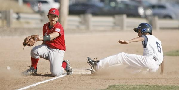 Andy's of Crescenta Valley third baseman Will Rees, left, attempts to make a play on a ball, while Glendale Jewel City/Jewish War Veterans Bears runner Matthew Bajanian slides in safely.