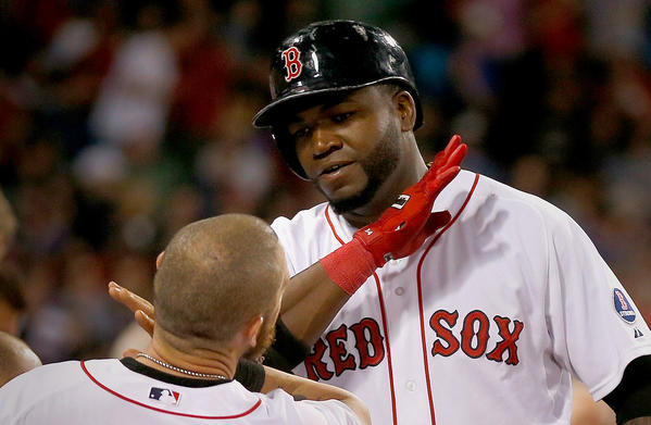 Boston Red Sox's David Ortiz celebrates his two-run home run against the Angels in the sixth inning during the second game of a doubleheader at Fenway Park.