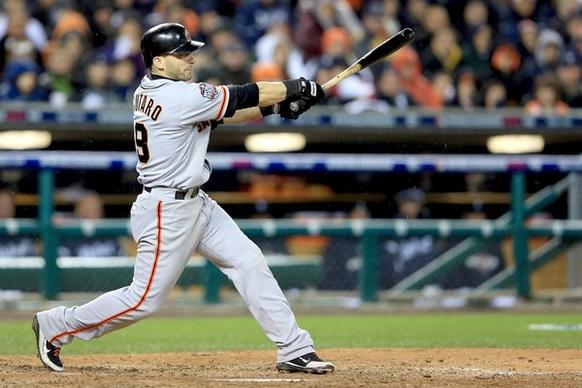 Giants second baseman Marco Scutaro drives a single to center field to score Ryan Theriot with the eventual winning run against the Tigers in Game 4 of the World Series on Sunday night in Detroit.