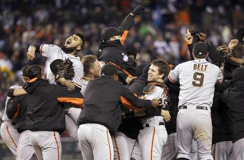 The Giants celebrate clinching the World Series title with a 4-3 victory over the Tigers in Game 4 on Sunday night at Comerica Park in Detroit.