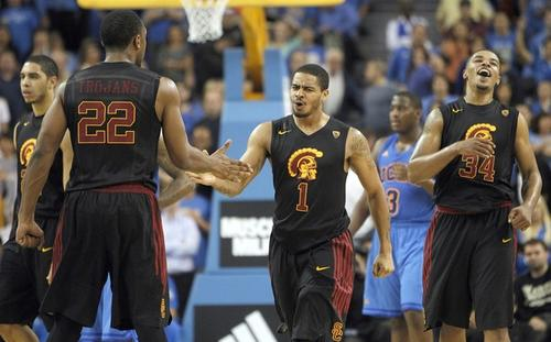 USC guard Jio Fontan (1) celebrates with teammates after their 75-71 victory over UCLA on Wednesday night at Pauley Pavilion.