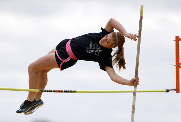 Autumn Pitz, of Ipswich, clears the bar in the girls pole vault event Saturday at the USATF Dakotas Junior Olympics Track and Field Championships at Swisher Field. photo by john davis taken 6/8/2013