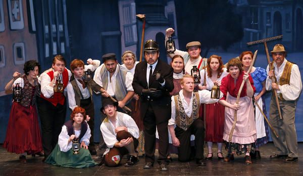 Villagers in a scene from the Aberdeen Community Theatre production of Young Frankenstein.
