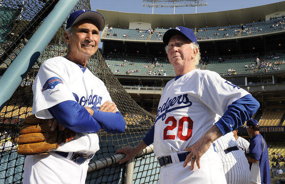 Former Dodger pitchers Sandy Koufax, left, and Don Sutton chat before an old-timers game at Dodger Stadium Saturday.
