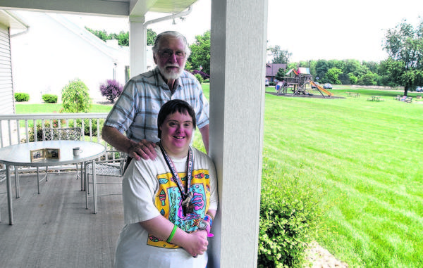 Cindy Casper, 37, stands with her father, Jerry Casper, on the back porch of the home Cindy moved into Saturday at the Hannah & Friends complex on Hollyhock Road in South Bend. The Casper family leased the property in the past and they spent many years riding horses on the property.