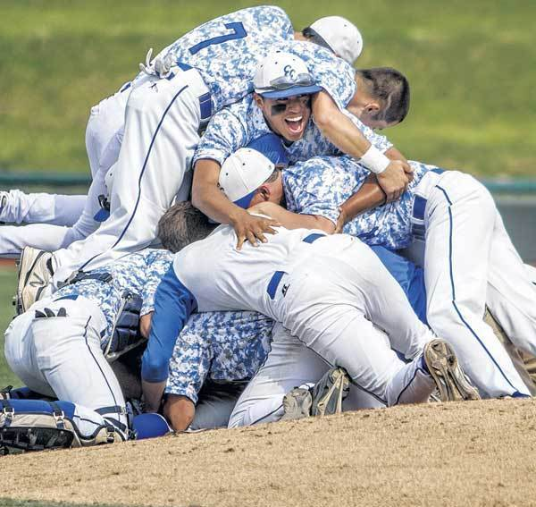 Elkhart Central players celebrate their 2-1 victory over Lafayette Jefferson in the Class 4-A semistate game Saturday at Coveleski Stadium.