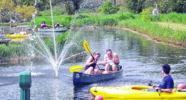 The spray of a fountain greets paddlers on this pond at the new rental business, T&L Country Canoes in Shipshewana, as they make their ways to and from the Fawn River.