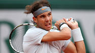PARIS -- Rafael Nadal made light work of fellow Spaniard David Ferrer to win a protest-interrupted French Open final 6-3, 6-2, 6-3 on Sunday and become the first man to win eight singles titles at the same tournament.