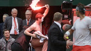 PARIS --  Open organizers defended their security arrangements after protesters, one letting off a flare and running on court, briefly interrupted the final between Rafael Nadal and fellow Spaniard David Ferrer on Sunday.