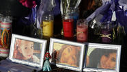 "At a roadside trbute, flowers, candles, letters and photos of three Irvine High School students killed in a Memorial Day crash: from left, sisters Robin Cabrera, 17, and Aurora ""Christine"" Cabrera, 16, and Cecilia Zamora, 17. (Allen J. Schaben / Los Angeles Times / May 29, 2013)"