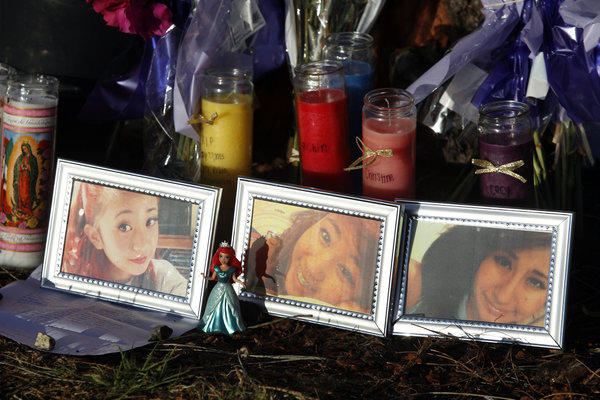 "At a roadside trbute, flowers, candles, letters and photos of three Irvine High School students killed in a Memorial Day crash: from left, sisters Robin Cabrera, 17, and Aurora ""Christine"" Cabrera, 16, and Cecilia Za"