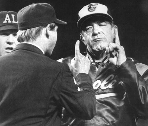Orioles manager Joe Altobelli raises his finger to first base umpire Jim Evans during an argument over a call in the 8th inning against the Calfornia Angels at Anaheim Stadium. Altobelli was fired by the O's on June 13, 1985.