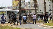 BEIRUT — A Lebanese demonstrator was shot dead outside the Iranian embassy here Sunday when clashes erupted against the Shiite militant group Hezbollah's widening involvement in the neighboring civil war in Syria.
