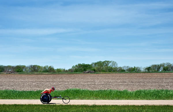 Paralympic athlete Ryan Chalmers pushes his racing chair in Douglas County, Kansas, Monday, May 13, 2013.