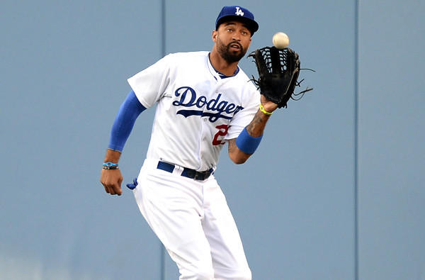 Dodgers center fielder Matt Kemp catches a fly ball hit by Angels first baseman Albert Pujols last month at Dodger Stadium.