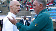 Coach Bob Bradley's surprising Egyptian team moved a giant step closer to qualifying for the 2014 World Cup next summer in Brazil, riding Mohamed Salah's hat trick to a 4-2 victory over Zimbabwe on Sunday in Harare.