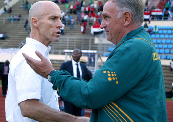 Egypt Coach Bob Bradley, left, greets Zimbabwe Coach Klaus Dieter Pagels after their World Cup qualifying game Sunday.