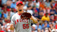 BOSTON — Joe Blanton is halfway to history, but not the kind the Angels hoped he would make.