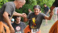 Runners get down and dirty at Carroll Mud Run