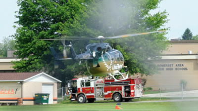 Allegheny General Hospital Life Flight takes off from the Somerset high school soccer field with a patient.
