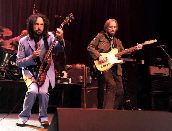 Tom Petty, right, and Mike Campbell of the Heartbreakers during Monday's gig at the Fonda. On Saturday, fire marshals shut down their concert after deeming it over capacity