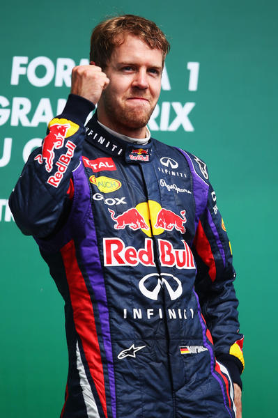 Sebastian Vettel of Germany and Infiniti Red Bull Racing celebrates on the podium after winning the Canadian Formula One Grand Prix at the Circuit Gilles Villeneuve on June 9, 2013 in Montreal, Canada.
