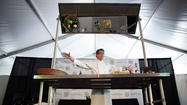 When Rick Bayless released his first cookbook, he had hoped each and every one of his readers would immediately be toiling over a pot of Oaxacan mole in the kitchen, he told the crowd Saturday during his cooking demonstration at Printers Row Lit Fest. Everybody laughed, and so did Bayless.