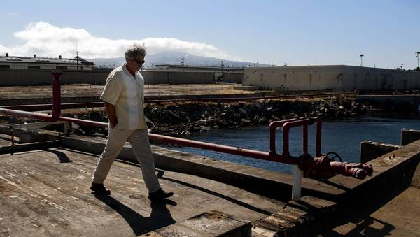 Daniel Pondella, director of the Southern California Marine Institute, walks along 100-year-old City Dock 1 at the Port of Los Angeles, which will be transformed into a research center containing laboratories and classrooms, fish hatcheries and berths for research vessels. His institute will be the new center's first tenant.