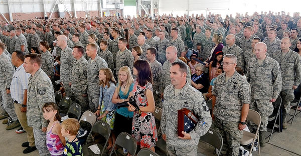 Servicemen and women and their families of the 167th Airlift Wing stand at attention during a ceremony to salute them on Sunday in Martinsburg, W.Va.
