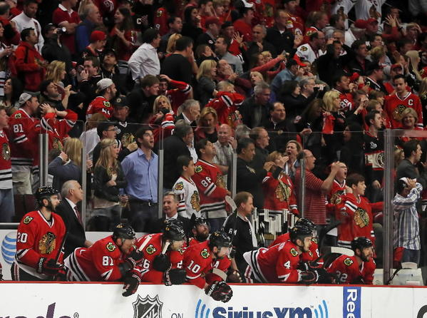 Fans cheer the Blackhawks during Saturday's Game 5 at the United Center.