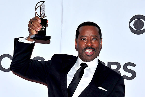 "Courtney B. Vance poses with his award for best featured actor in a play for ""Lucky Guy"" in the press room."