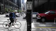 Chicago's first two-way protected bike lanes have been in place for six months through the center of downtown on <strong>Dearborn Street</strong>, and the experience so far has led city officials to conclude that all cyclists really need to obey traffic laws are signals of their own, telling them that stop means stop.