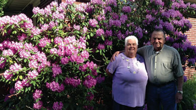 Darla and Joe Delancy stand in front of their prized rhododendron bush at their Brothersvalley Township home.