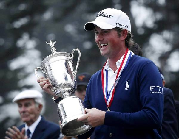 Webb Simpson holds the the U.S. Open Championship Trophy after winning the 2012 tournament on the Lake Course at the Olympic Club in San Francisco last June.