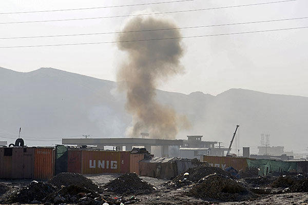 Smoke rises from a building where insurgents were believed to have holed up near Kabul airport.