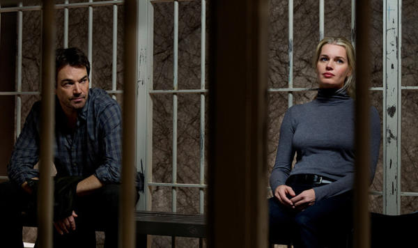 "Jon Tenney and Rebecca Romijn are stuck in bad-plot jail on TNT's ""King & Maxwell."""