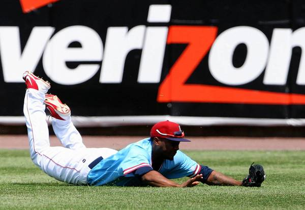 IronPigs right fielder Leandro Castro dives for the ball against Charlotte during fifth-inning action at Coca-Cola Park in Allentown on Sunday.