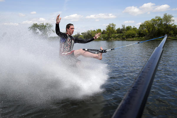 Noah Leach of the Aqua Addicts skis on one foot on Mina Lake Friday. American News Photos by John Davis